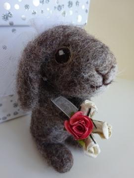 She holds paper roses